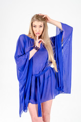 Beautiful long-haired blonde in a clear blue tunic