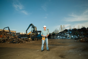 worker in scrap metal recycling center