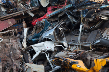 damaged cars in recycling junkyard