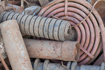 stack of rusted pipes