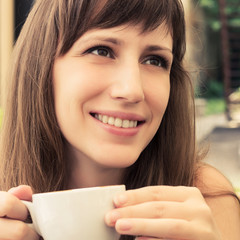 Portrait of young woman dreaming in cafe