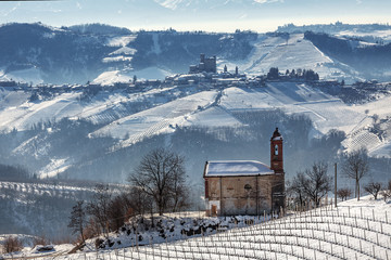 Small church and wintry hills.