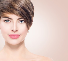 Beautiful young spa woman with short hair portrait