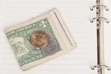 US coins on an empty notebook page