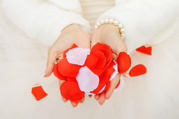 Bride holds rose petals