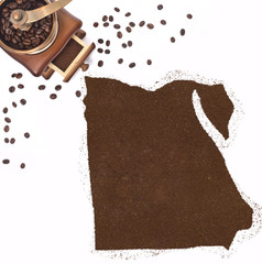 Coffee powder in the shape of Egypt and a coffee mill.(series)