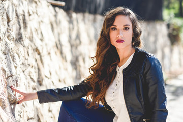 Girl with long hair wearing leather jacket