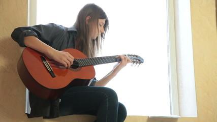 Teen Girl Playing Guitar At Home