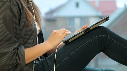 Teenager girl listening music on your digital tablet