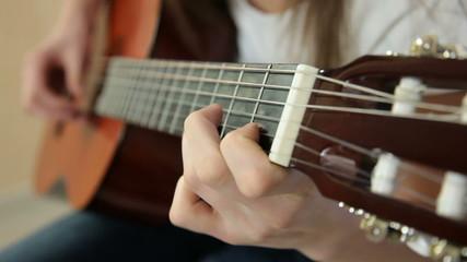 Young Girl Playing Guitar Close-up