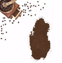 Coffee powder in the shape of Qatar and a coffee mill.(series)