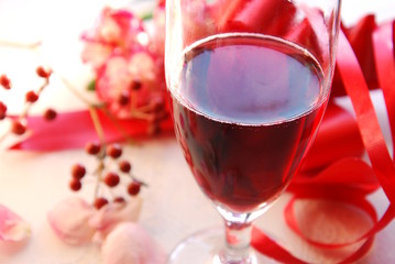 sparkling wine with flower and ribbon