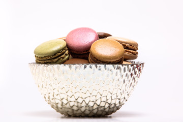 Colored macarons inside bowl