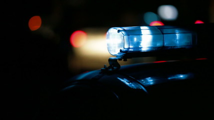 police car on the road at night