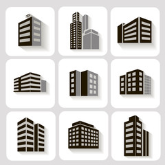 Set of dimensional buildings icons in grey and white with shadow
