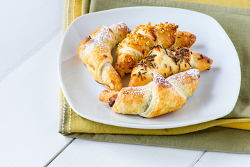mixed croissants in white plate