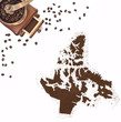 Coffee powder in the shape of Nunavut and a coffee mill.(series)