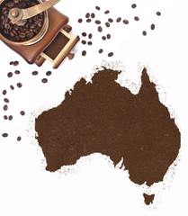 Coffee powder in the shape of Australia and a coffee mill.(serie