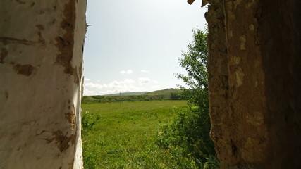 window of old abandoned farm house