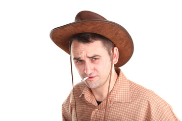 Man with cowboy hat is smoking