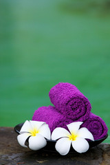 Towels with white frangipani flowers.