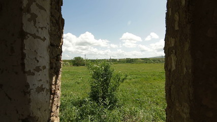 View from the window of abandoned farmhouse at countryside