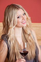 Woman with a glas of red wine