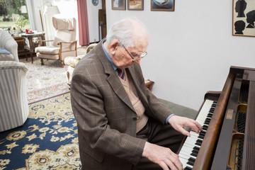 Old man at the grand piano