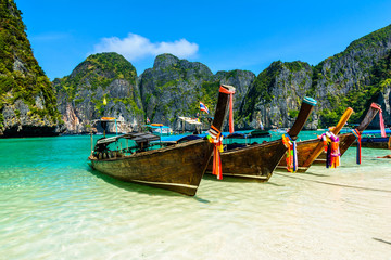 Long-tail boats in Maya Bay, Andaman sea, Thailand, South Asia © davidionut