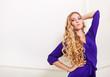 Beautiful blond woman in long violet dress