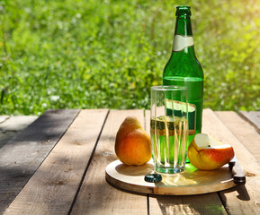 Pear cider and pears on the summer picnic