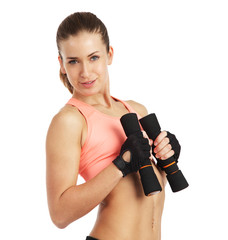 Fit woman with dumbbells - isolated over white background
