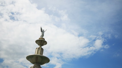Angel Statues with clouds running background.