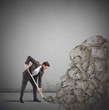 Businessman removes an obstacle rock