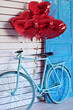 Blue bicycle with heart-shaped balloons. Valentine's day.