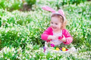 Pretty little girl on Easter egg hunt