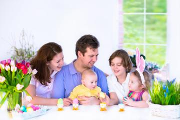 Family having breakfast on Easter day