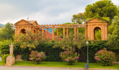 Ancient building in the park on a street in Barcelona