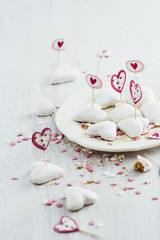 White heart shaped white cookies and toothpicks