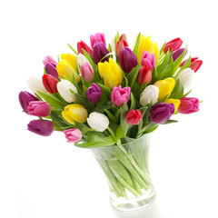 Pastel tulips in a glas vase