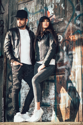 young urban couple posing - 76260396