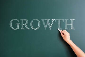 writing growth on blackboard