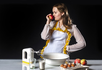 Smiling homemaker sniffing apple