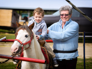 Boy on his First Pony Ride with his Grandmother
