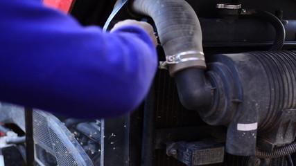 Farmer is putting pushcart engine air filter