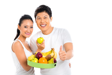 Chinese Asian couple eating healthy fruits