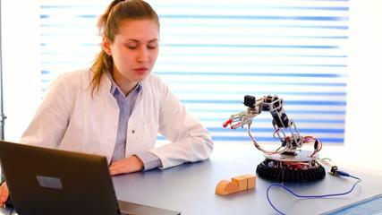 cientist adjusts the robot arm