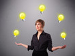 young lady standing and juggling with light bulbs