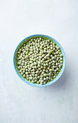 Organic green dried peas in a bowl