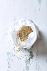 Organic quinoa in a paper bag